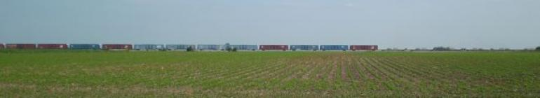 long train going across prairie